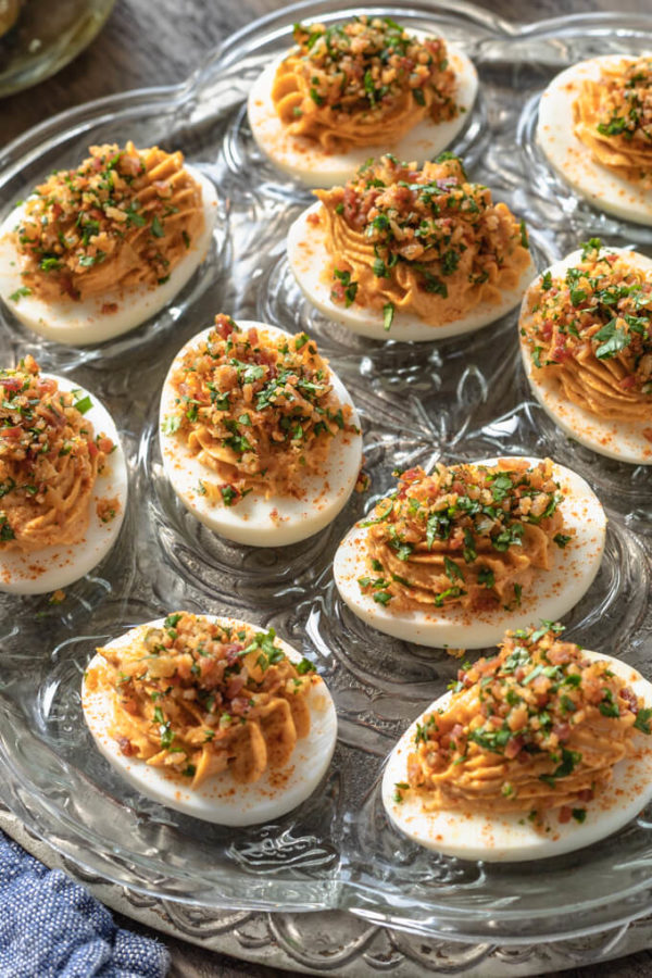 Spicy deviled eggs with bacon and cilantro