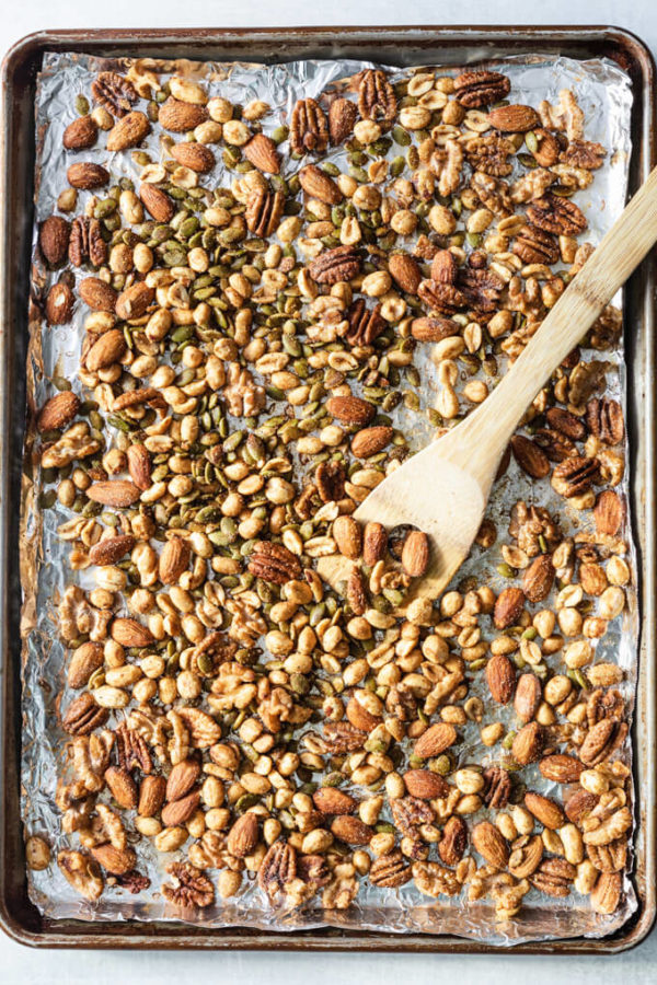 Mixed keto nuts mix on baking sheet after seasoning and cooking