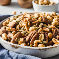 Savory keto nuts snack mix in serving bowl with blue naptin