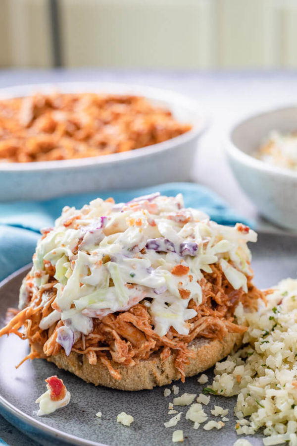 Crockpot BBQ chicken on roll with coleslaw